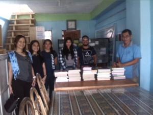 Dr. Gina Lamzon, SAMASIKOFIL president Queny Juntilla, Reychelle Macaspac,  Beatriz Adalin and Cezar Zaldivar turn over books to Mike Alon.